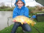 This is 9 year old Aidan Smith with his first super mirror carp caught from the North Pool on ledgered sweetcorn.