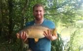 Here's Alistair Hook with a super 15.5lb carp caught from the Match Lake on floating bread in the reeds.