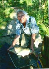 This is Archie Scragg with a lovely common carp.  Archie is a regular visitor to our campsite.