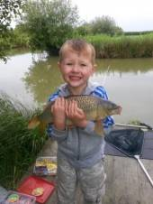 Ashton with a lovely common carp from Rushcombe Lake.
