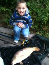 This is Ben Hendy, aged 7, on only his 2nd-ever fishing trip with a lovely 9lb mirror carp from the Match Lake caught on sweetcorn.