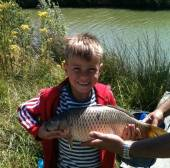 This is Billy Pring from Shirehampton with a nice common carp caught on bread from our Rushcombe Lake.