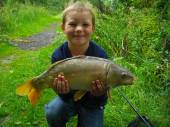 This is 8 year old Brandon Steel with two of the cracking fish he caught on his first trip to Bullock Farm.  Brandon used 16mm pineapple pellet over a bed of scopex sweetcorn from peg 1 of the Carp Lake.  This fish weighed in at 8lb 4oz.