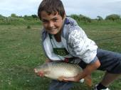 This is Charlie Towner on only his 2nd day's fishing when he caught this beautiful 6lb 4oz common carp from Rushcombe lake.