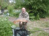 This is Dave Brown with a superb 18.5lb fish from peg 13 of the Carp Lake - caught on plastic corn.