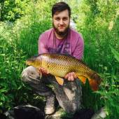 Here's Declan Coppock with a super common carp caught from peg 12 of the Carp Lake on double 8mm pellet on a bed of micro pellets.