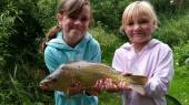 Ella & Lydia with a super 4lb common carp from the South Pool