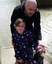 Ella Pitman with her first ever fish - caught on a bright pink fishing rod!