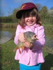This is Emily, aged 4 (sister of Lucy - see photo below) with her first fish.  Super photo!