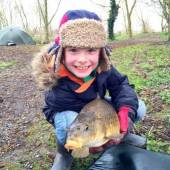This is 7 year old Finn with a super common carp caught on his first ever fishing trip!