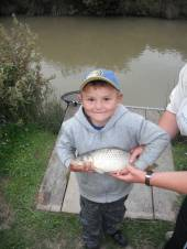 Jack Glew aged 6yrs with a common carp weighing 2 1/2lb caught on bread flake floated on top.