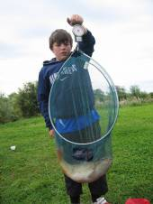 Harry Bailey, aged 12 from Hednesford in Staffordshire stayed with us on holiday with his grandparents.  Harry was fishing on a telescopic pole, 4lb line, a size 16 hook using size 10 elastic, with floating bread.  In a 5 hour session Harry landed 17 fish that totalled over 27lb.  Best of all was a fabulous 5lb common carp which, at the time was a new record for this lake.