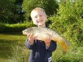 This is 5 year old Harry Parfitt from Yatton with his first fish, a lovely common carp from Rushcombe lake caught on softened pellet and a shortened pole.  Harry nick-named the fish 'Big bad Barry'!