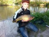 This is Harry with his first fish, a lovely common carp, caught from the Match Lake.
