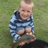 This is Jack Wilkins aged 5 with his first ever fish.  Jack caught it proudly using his late Granfer's (Jon Wilkins) pole with a size 16 hook and a single maggot.