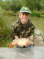 Gary Hutchings of Clevedon sent us this great photo of 10 year old Jake with his very first fish, a nice common carp of around 3lb, caught just half an hour into his first fishing trip.  Jake used a single white maggot on a size 16 hook, 3lb line float, fishing over a small handful of maggots as loose feed from peg 17, fishing in open water half way to the island of the North Pool.