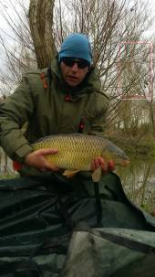 Jamie Tustin with a beautiful 12lb common carp from peg 20 of the Carp Lake.