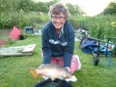Joan Barratt from Stotfold in Hertfordshire, recently stayed in the Six House.  Joan had never fished before and was delighted to land this beautiful 5lb 12oz mirror carp on her second attempt.  Joan fished the North Pool using a roach pole.