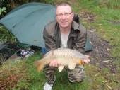 This is John Allison with his personal best 8lb commons caught on sweet corn from the Carp Lake.
