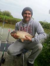 This is Ashton's Dad, Lee with a lovely common carp. Lee and Ashton's fish were caught using a 5ft coarse rod with a 12 hook and  12lb line using spam for bait and a small stick float with plumb weight.