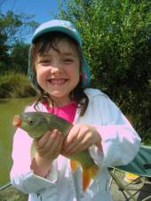 Lucy, aged 5, fished with her Grandad on Rushcombe Lake using single sweetcorn on a size 18 hook.