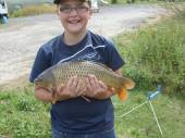 This is Luke Nix with the largest fish caught from Rushcombe Lake so far!  Luke caught this lovely 10lb common carp on the pole with a size 16 hook and luncheon meat from the margins of peg 5.  Luke finished up with a 90lb bag of fish.