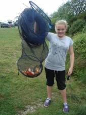 This is Martin Jones' daughter who caught around 24 fish from Rushcombe using mainly maggot on a 3 meter whip and a light rig.