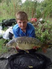 Max Lamprey, aged 13 from Bristol, fished the Carp Lake for the first time to take a personal best fish of 15lb from peg 6.  He fished half way out tight to the reeds on a hair-rigged piece of pepperami on a size 6 hook to a 12lb line and a 15lb hook length.  His previous personal best was 11lb and he also bagged a 7lber and 3 other smaller fish.