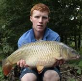 Here's Mitchell Davenport with a lovely 11.4lb common from the Carp Lake.