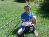 This is Mitchell Raymond with what looks suspiciously like a roach in our all carp Rushcombe Lake!