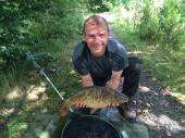 Neil Hyatt with a lovely linear mirror carp from the South Pool.