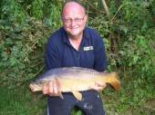 This is Paul Rothwell, a regular visitor to our holiday cottages with a super mirror carp.