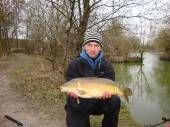 This is Rafal Rybarczyk with a beautiful 11lb carp caught with corn on the hook from the Match Lake.