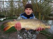 This is Rafal Rybarczyk with a lovely common from the Carp Lake caught on corn.