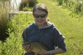 This is Rebekka Johnson, one of our season ticket holders, with a nice common carp caught from the North Pool