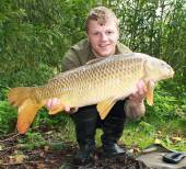 This is Ricky Seery with a lovely 12.6lb common from the Carp Lake.