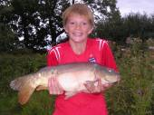 "Richard Latham sent us this great photo of his son Robert with the 8.5lb mirror carp he caught from the North Pool.  Robert is 11 years old, from Portishead, and has only just taken up fishing.  Earlier in the session he caught a 3lb common carp, his first fish of any size, following up with this beauty. Robert was fishing with luncheon meat on a size 14 hook, 6lb line and legering in open water. As Richard says ""the look on his face says it all""."