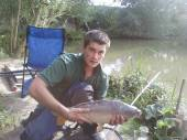 This is Sam Hutchings with a lovey mirror carp from the Match Lake.