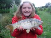 This is Sarah Page with her biggest ever fish caught from the Hovis pegs on the North Pool.  It took her 15 minutes to land it.