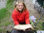Here's Sarah again with another lovely carp.  She and Dad, Simon, used 16 hooks, 3.5lb line on float fished maggot.