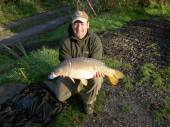 Shaun Collins a Field Service Engineer from Bradley Stoke, caught this beautiful 14.5lb mirror on 23rd October 2007 using a piece of cubed bacon grill from peg 4 of the Carp Lake in the margins.