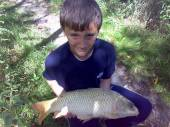 "Thomas Williams, aged 10, told his Dad, Pete, he wanted to try his hand on the Carp Lake as a change from the North Pool.  He managed to catch his best fish ever - a 9.5lb mirror from peg 14.  He also sent us these pictures of two lovely 8lbers caught from peg 10, using luncheon meat float-fished on a size 10 hook.  As his Dad says ""despite the nervous smile, he's as happy as a Bristol City fan in the championship!""."
