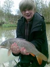 This is Tom with a lovely common carp he caught during a holiday in our self-catering cottages with his Mum & Dad.