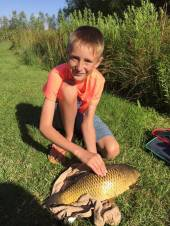 Young Tom Wilkins caught his personal best fish - this beautiful common carp, with the top 2 sections of a pole and light tackle 2ft out from the bank of the North Pool.