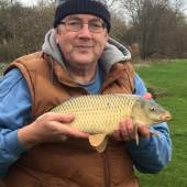 Tony Stephens with a nice 4lb 13oz common from Rushcombe Lake.