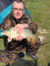 Tony Stephens with a nice 6.5lb mirror carp caught on Rushcombe using pellet and slow sinking nugget.